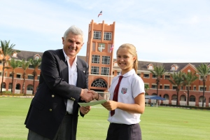 Poppy being congratulated by the Chairman of Round Square on receiving the Kurt Hahn Medal for contribution to service