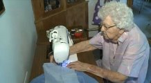 Lillian Weber making dresses for others