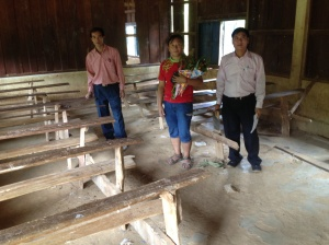 Chipseng with the Headteachers of Pak Xeng School in a typical classroom
