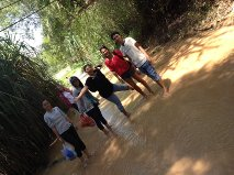 walking in the river to the sand dunes